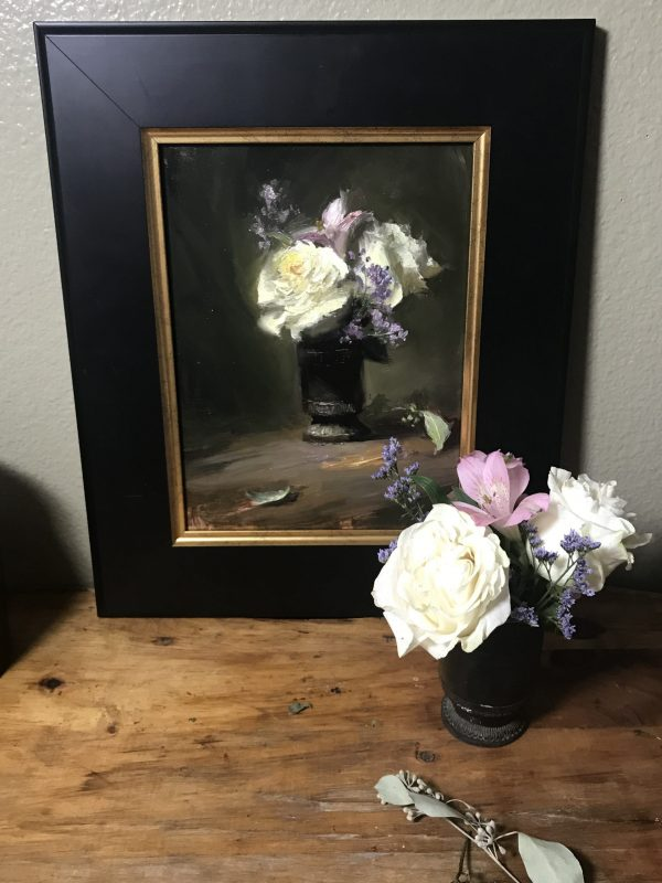 A photo of a framed original still life painting on panel of white roses and purple flowers.