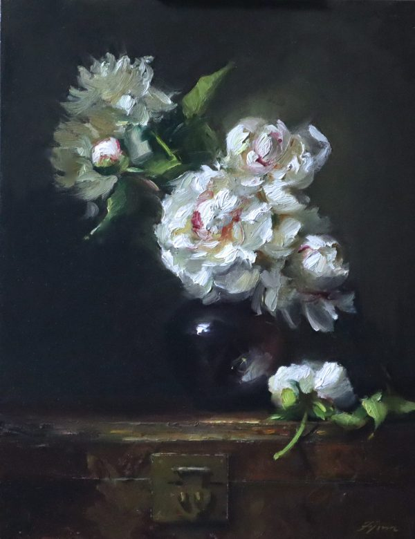 A photo of an original oil painting on panel of a still life painting of white peonies on an antique Japanese lacquered trunk