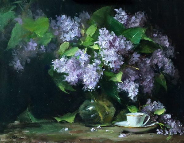 A photo of an original oil painting on panel of a floral still life of lilacs in a glass vase with a white teacup.
