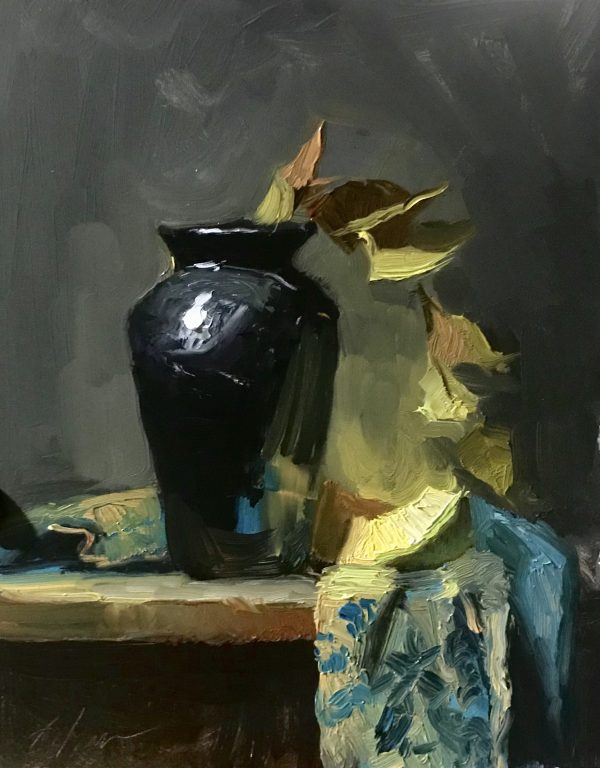 A photo of an original oil sketch on panel of a still life painting of a cantaloupe and a black vase with green leaves.