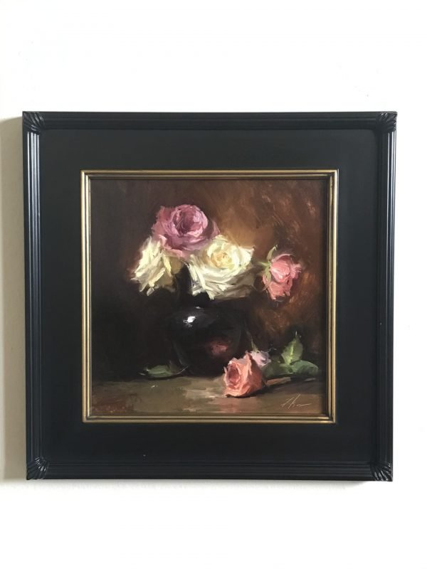 A photo of a framed original oil painting on panel of a still life painting of white and pink roses in a vase.