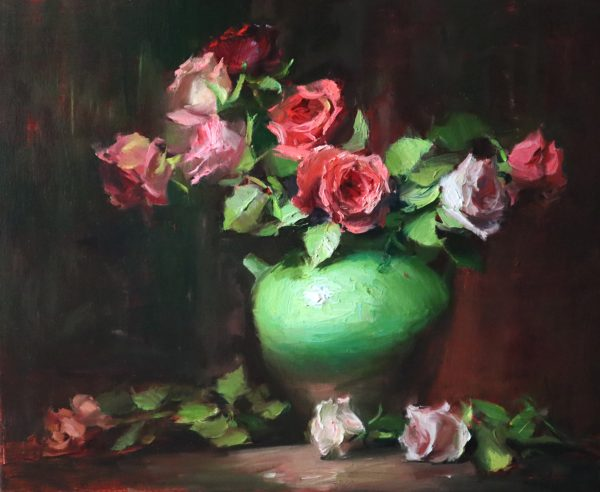 A photo of an original oil painting on linen of a still life painting of red and coral roses in a green jar.