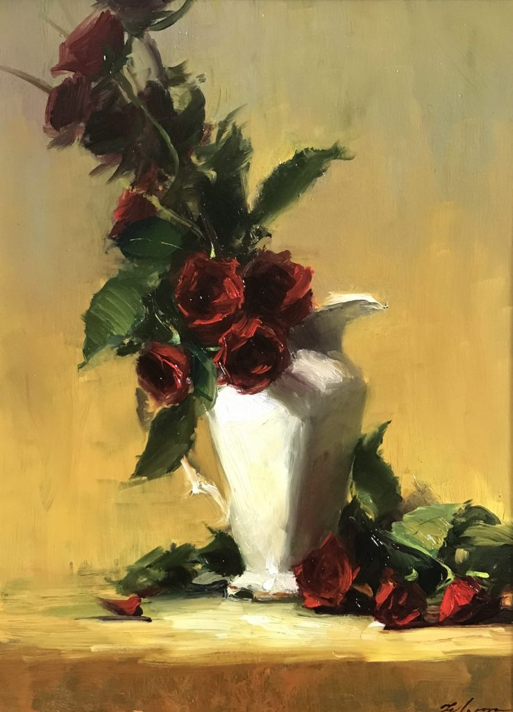A photo of an original oil painting on panel of a still life painting of red roses in an ivory vase.