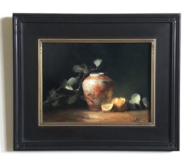 A photo of a framed original oil painting on panel of a still life painting of a peony ginger jar and oranges.