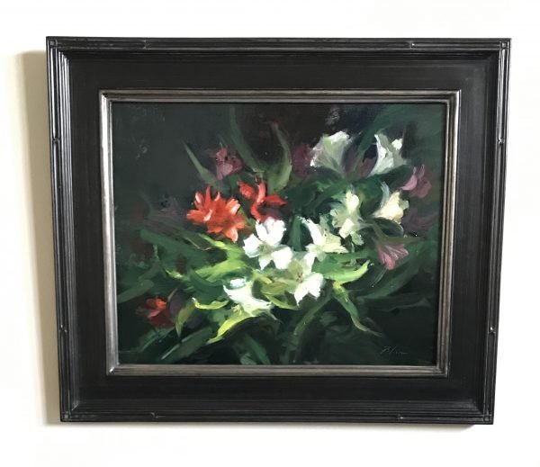 A photo of a framed original oil painting on panel of a still life painting of red and white lilies.
