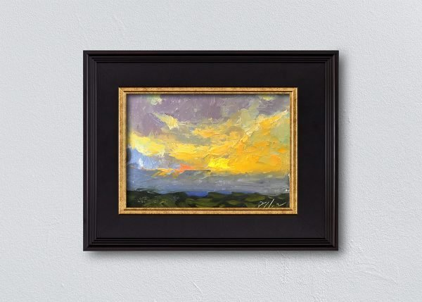 Sunrise Twenty-Four Black Framed by Kelli Folsom.
