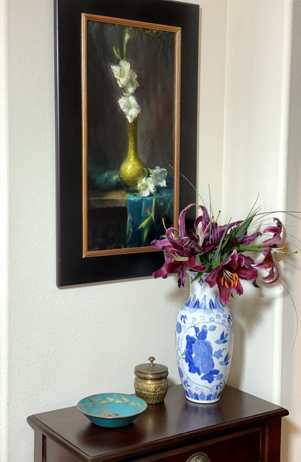 An original oil painting of a still life with a brass vase and white gladiolus and turquoise silk fabric by Kelli Folsom