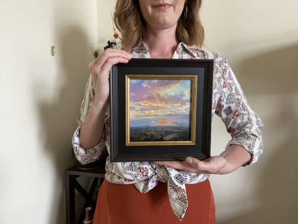 Kelli Folsom with her original oil painting of a Sunrise day number twenty nine oil on panel.