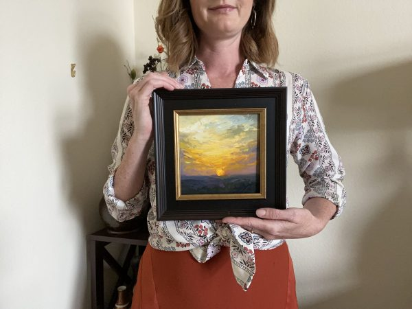 Kelli Folsom with her original oil painting of a Sunrise day number twenty eight oil on panel.
