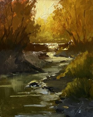 A photo of an original oil painting on panel of a landscape painting of an autumn creek by Kelli Folsom.