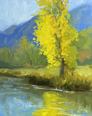 A photo of an original oil painting on panel of a landscape painting of gold trees in the blue mountains by Kelli Folsom.