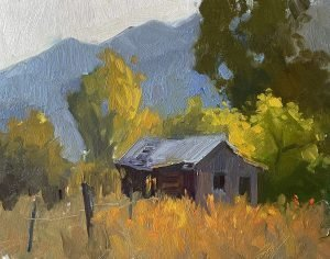A photo of an original oil painting on panel of a landscape painting of a old shed in the mountains.