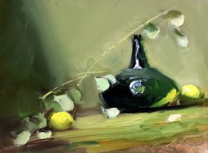 A photo of an original oil sketch of a still life painting on panel of an emerald green bottle and lemons by Kelli Folsom.