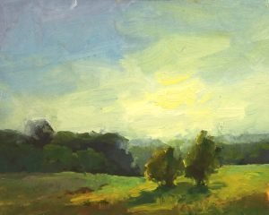 A photo of an original oil sketch of a plein air painting of pasture glow by Kelli Folsom.