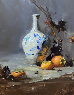 A photo of an original oil sketch on panel of a still life painting of a porcelain vase and persimmons by Kelli Folsom.