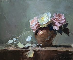 A photo of an original oil sketch on panel of a still life painting of roses in a small copper vase by Kelli Folsom.