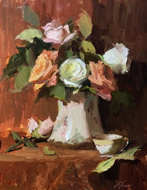 A photo of an original oil painting on panel of a floral still life of roses in a porcelain vase by Kelli Folsom.