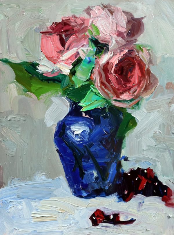 A photo of an original oil painting on panel of a floral still life of peach roses in a blue vase.