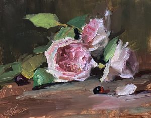 A photo of an original oil painting on panel of a floral still life pink Valentine's roses by Kelli Folsom